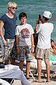 tom felton jade olivia kiss beach 02