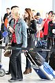 lily collins jcb separate toronto departures 02