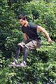 taylor lautner bike riding for tracers filming in nyc 01