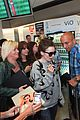lily collins jamie campbell bower arrive in berlin 17