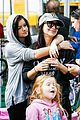 ariel winter makes a furry friend at the farmers market 03