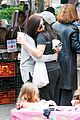 ariel winter makes a furry friend at the farmers market 19