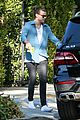 harry styles steps out before taylor swift out of woods drops 26