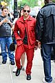 nick jonas red suit aol build appearance 10