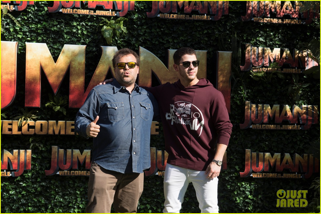 jack black nick jonas face off during jumanji promo 03