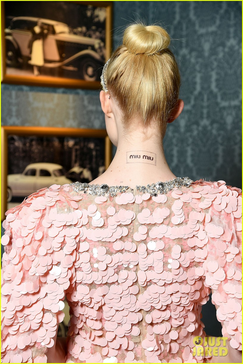 elle fanning gets branded at miu miu fashion show 02