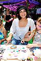 vanessa hudgens snaps selfies with fans at toy launch 03