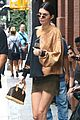 kendall jenner shows off her legs in olive green skirt and oversized sweatshirt 02
