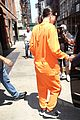 kendall jenner wears all orange for her flight out of new york 05