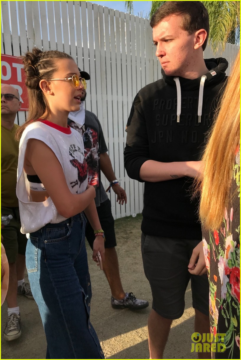 millie bobby brown checks out cardi bs coachella performance 05