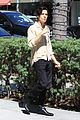 cole sprouse snaps a pic with a fan while running errands in la 01