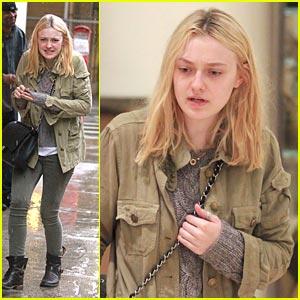 Dakota Fanning Braves The Rain For Barneys New York