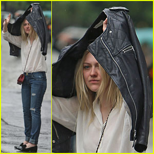 Dakota Fanning Hides From the NYC Rain!