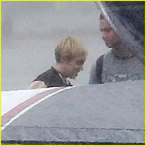 Miley Cyrus & Patrick Schwarzenegger Hit Rain Before Private Flight Out of Los Angeles