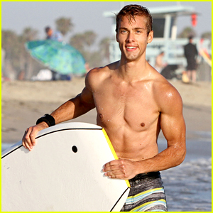 Shirtless Austin North Gets Wiped Out by Waves While Boogie Boarding