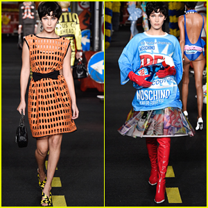 Bella Hadid Carries A Giant Windex Prop For Moschino Fashion Show in Milan