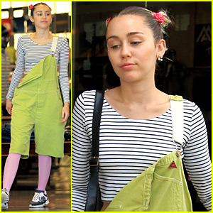 Miley Cyrus Wears Oversized Green Overalls with Pink Leggings