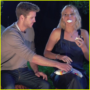 Jennifer Lawrence Stuffs Marshmallows in Her Mouth With Help From Liam Hemsworth (Video)