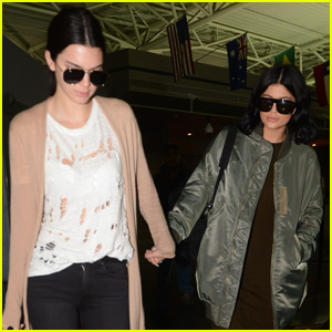 Kendall & Kylie Jenner Hold Hands While Landing in New York City