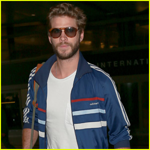 Liam Hemsworth Looks Straight Out of the 80s at LAX Airport