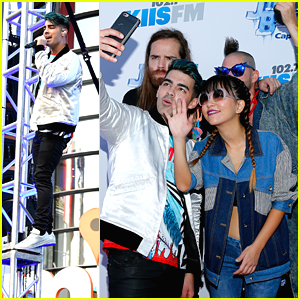 DNCE Gifts Selena Gomez With A Christmas Stocking At Jingle Ball LA 2015