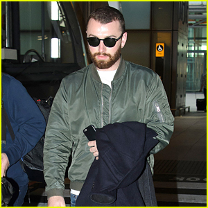 Sam Smith Is Welcomed With Hugs Upon London Landing