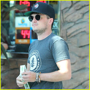 Josh Hutcherson Picks Up a Phone Charger from a Gas Station Store