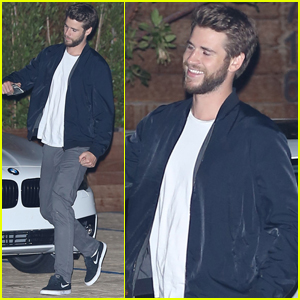 Liam Hemsworth Gets Silly With a Friend After Dinner