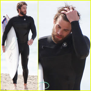 Liam Hemsworth Dreamily Runs His Hand Through His Hair at the Beach
