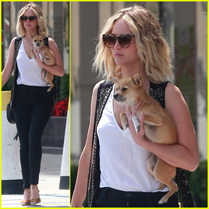 Jennifer Lawrence Cuddles Her Pup While Out & About in Westwood