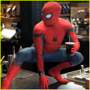 Spider-Man Surprises Starbucks Customers by Descending From the Ceiling - Watch Now!