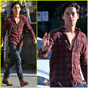 Cole Sprouse Dreamily Waves to Fans While Walking Down the Street