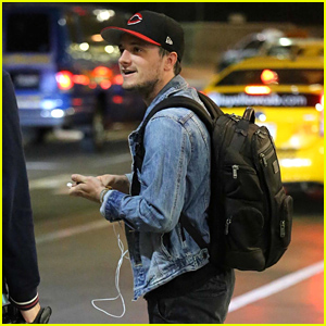 Josh Hutcherson Is in Good Spirits While Wearing a Leg Brace at the Airport