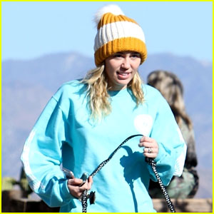 Miley Cyrus Rocks Cute Pom-Pom Beanie While Walking Her Dog