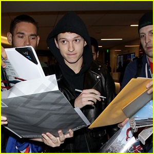 Tom Holland Gets Swarmed by Fans While Arriving at the Airport!