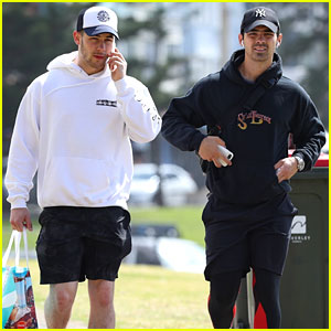 Nick Jonas Chats on the Phone While Stepping Out With Brother Joe