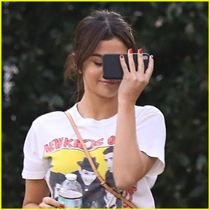 Selena Gomez Hides Behind Her Phone While Out in LA