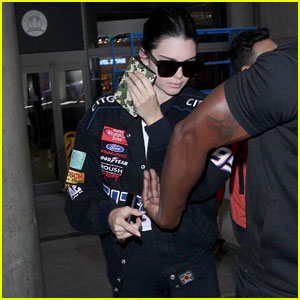 Kendall Jenner Sports Racing-Inspired Look While Returning to Los Angeles