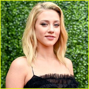 Lili Reinhart Meets Wolves At Wildlife Sanctuary in Canada