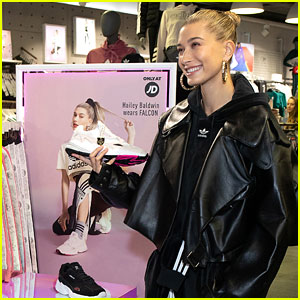 Hailey Baldwin Stocks Up On Adidas at JD on Oxford Street Store