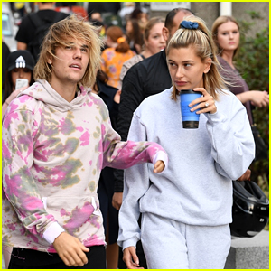Engaged Couple Justin Bieber & Hailey Baldwin Share a Smooch While in Line for the London Eye!
