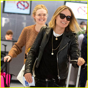 Elle Fanning Flashes a Grin While Landing in NYC After Paris Fashion Week