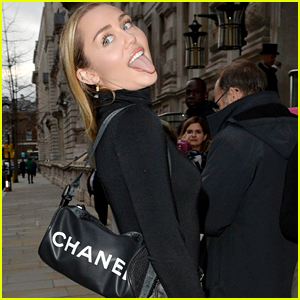 Miley Cyrus Sticks Out Her Tongue While Posing for Pics in London!