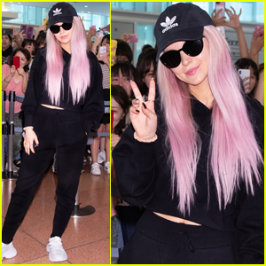 Dove Cameron Rocks Pink Hair While Arriving in Japan