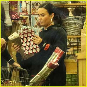 Demi Lovato Shops For Christmas Wrapping Paper