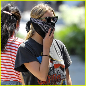 Ashley Benson Wears a Bandana Mask While Picking Up Food To Go in LA