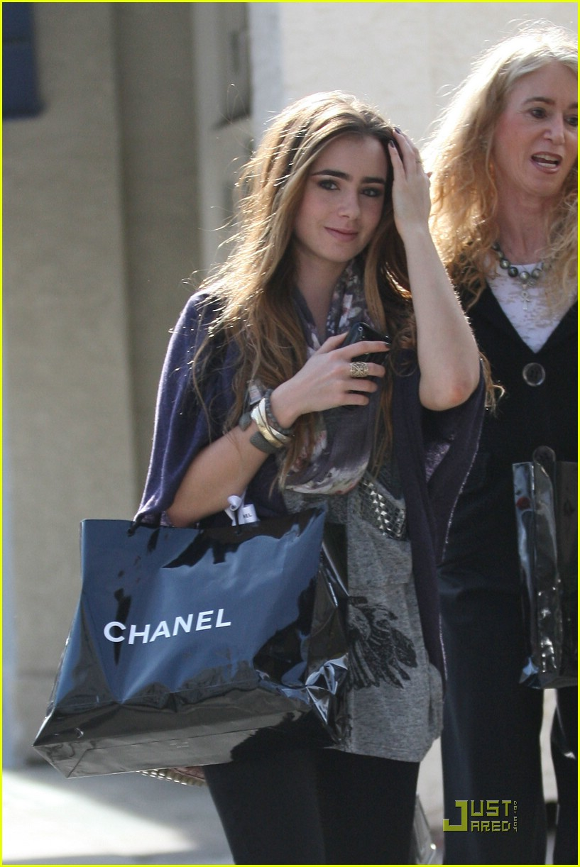 lily collins chanel shopping party 34