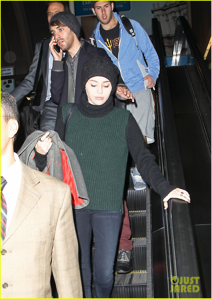 liam hemsworth picks miley cyrus up from lax 06
