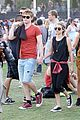 Roberts-lacoste emma roberts and evan peters hold hands at coachella 201404