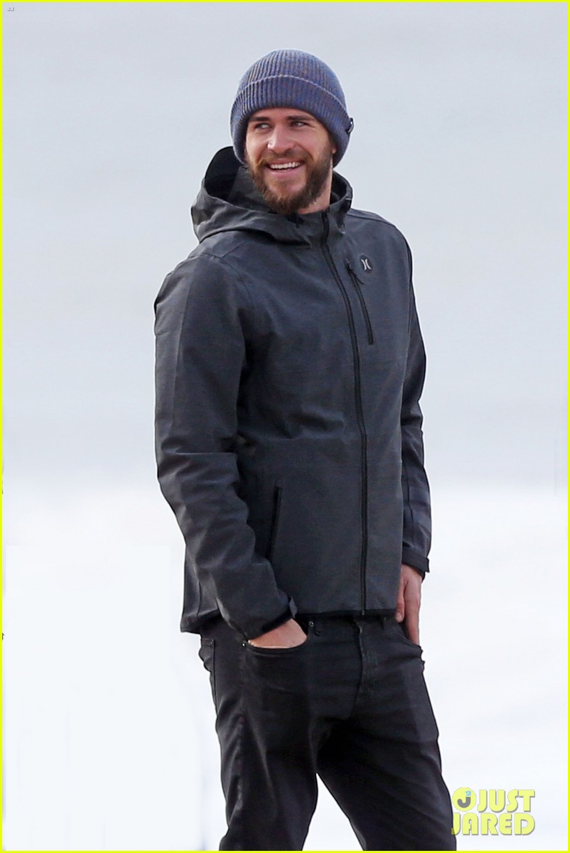 liam hemsworth and brother luke check out surf after socal storm 01